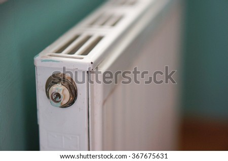 Close up of a white metal radiator - stock photo