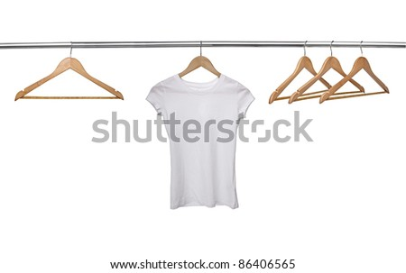 close up of a white t shirt on cloth hangers in row - stock photo