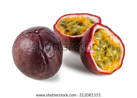 Close-up of a whole and split passion fruits (passionfruit, purple granadilla (Passiflora edulis)) isolated on white background. - stock photo