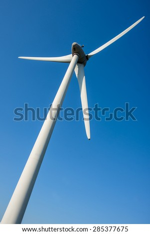 Close up of a wind turbine view from below