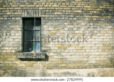 close up of a window on weathered brick wall /architechtural  detail
