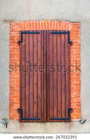 Close up of a window with wooden screens - stock photo