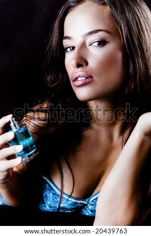 close up of a woman and pefume - stock photo