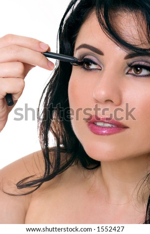 Close up of a woman applying eye pencil