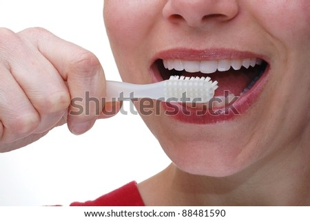 Close up of a Woman Brushing her Teeth - stock photo