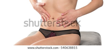 Close-up of a woman cares about her body applying cosmetic cream. Isolated on white background