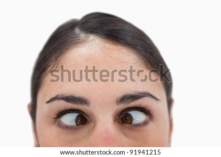 Close up of a woman cross-eyed against a white background