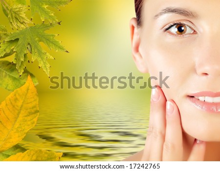 Close-up of a woman face in autumn frame - stock photo