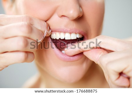 Close-up of a woman flossing 1