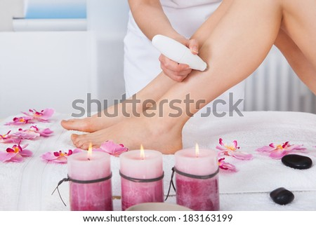 Close-up Of A Woman Getting Microdermabrasion Therapy In Spa - stock photo