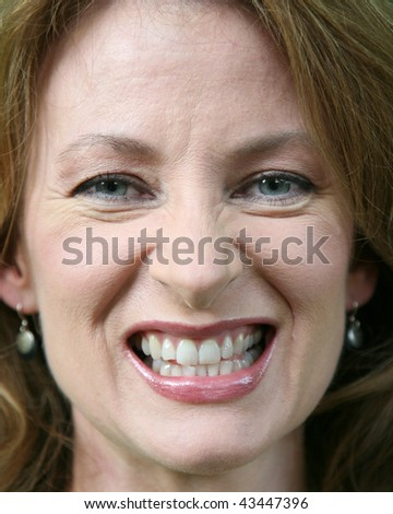Close up of a woman gritting her teeth