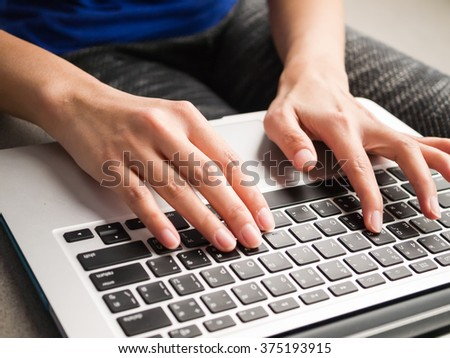 Close up of a woman hands working with a laptop - stock photo