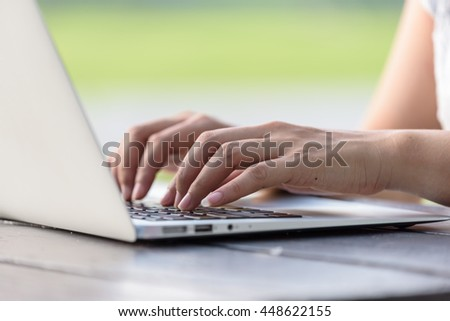 Close up of a woman hands working with a laptop at home