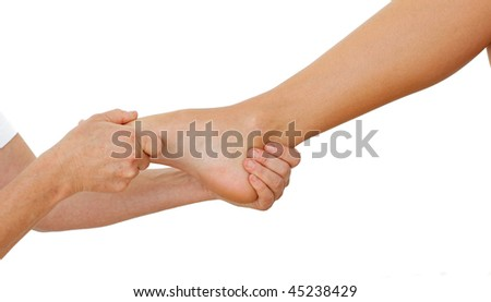 Close-up of a Woman having a foot massage against a white background