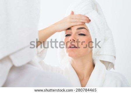 Close-up Of A Woman In Bathrobe Suffering From Fever
