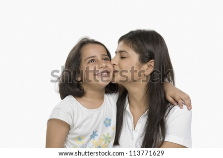Close-up of a woman kissing her daughter - stock photo