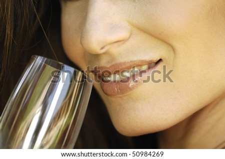 close-up of a woman mouth with a glass - stock photo