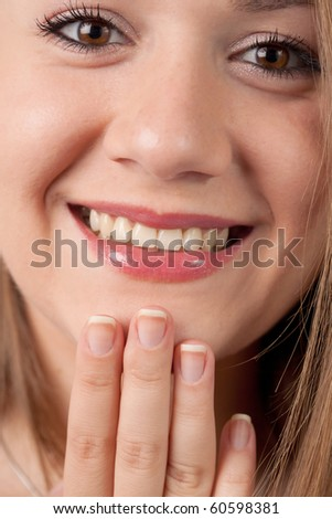 close-up of a woman smiling - stock photo