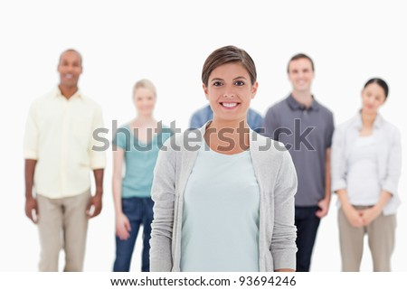 Close-up of a woman smiling with people behind her against white background