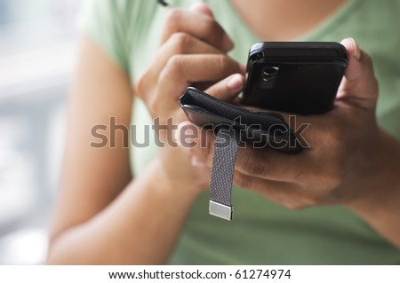close up of a woman using her cell phone. - stock photo