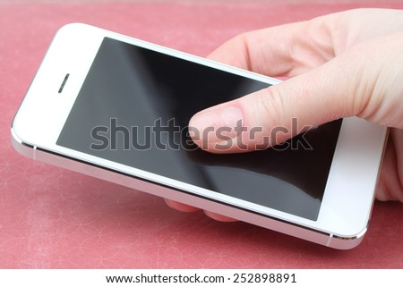 Close up of a woman using mobile smart phone indoor