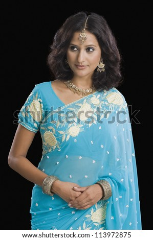 Close-up of a woman wearing a sari - stock photo