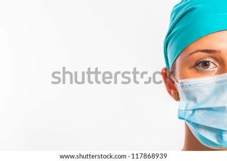 Close up of a woman wearing surgical gear