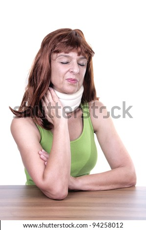 Close up of a woman with a surgical collar on white background - stock photo