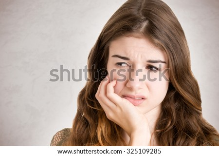 Close up of a woman with a tooth ache  - stock photo