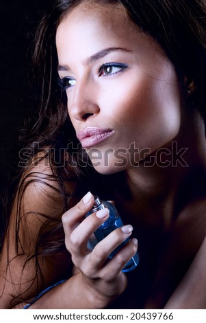 close up of a woman with perfume - stock photo