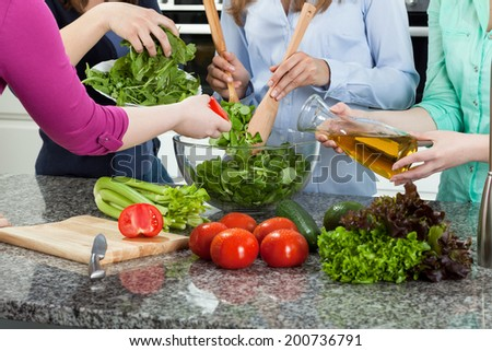 Close-up of a women preparing food for a party - stock photo