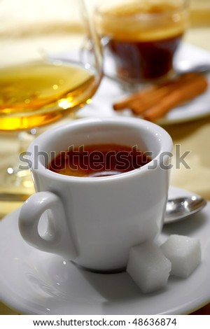 Close-up of a wonderful cup of hot coffee and cognac - stock photo