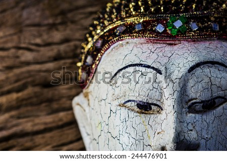 Close-up of a wood Buddha Sculpture - stock photo
