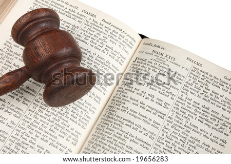 Close up of a wooden judge's gavel on an 1882 bible. - stock photo