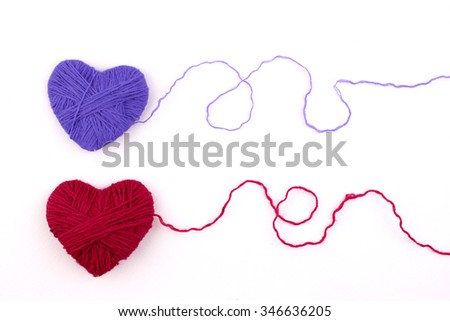 close up of a wool heart on white background - stock photo