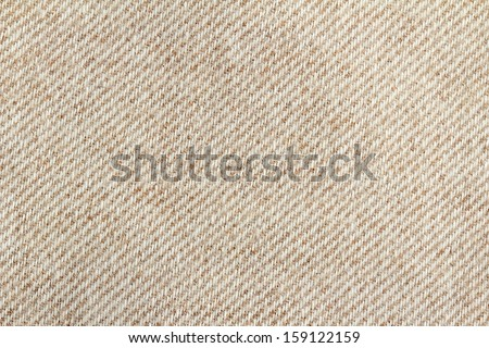 close up of a woolen fabric of beige color  - stock photo