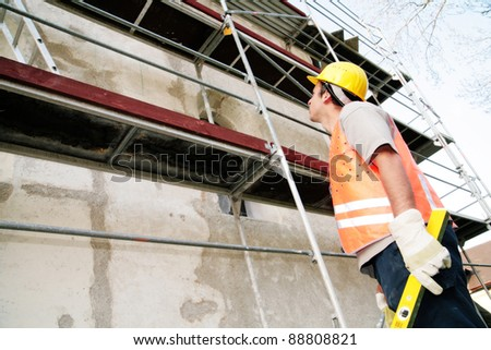 Close-up of a worker doing his job - stock photo