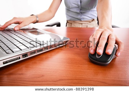 Close-up of a worker using a laptop computer - stock photo
