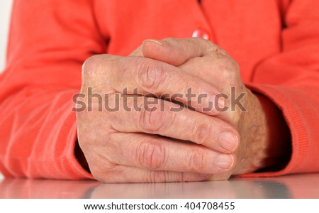 Close up  of a wrinkled elderly hand - stock photo