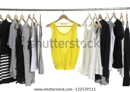 close up of a yellow dress fashion female clothing hanging on hangers - stock photo