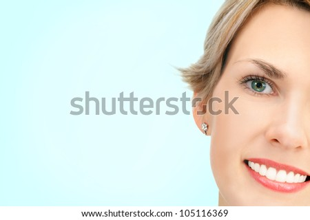 Close-up of a young beautiful caucasian blonde woman isolated over gradient light blue background, developed from Raw - stock photo