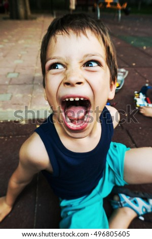 Close-up of a young boy shouting