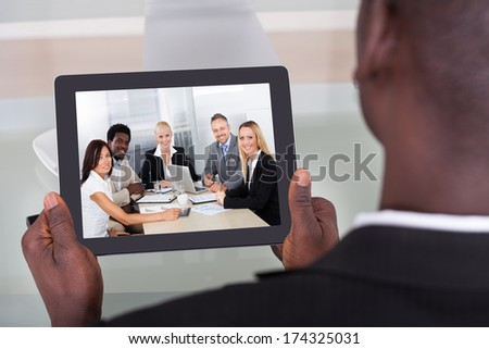 Close-up Of A Young Businessman Chatting With His Colleague - stock photo