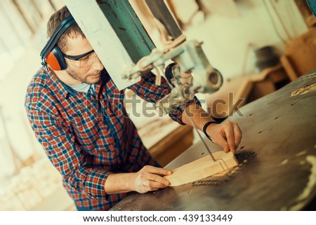 Close up of a young carpenter at work - stock photo