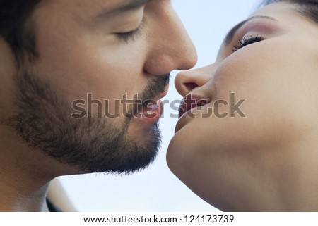 Close-up of a young couple romancing - stock photo