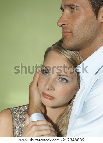 Close-up of a young man consoling a young woman - stock photo
