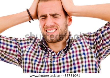 Close up of a young man having a intense headache. Isolated over white background.