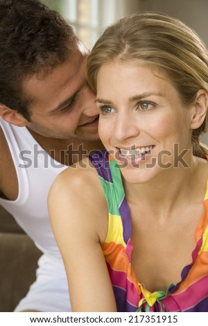 Close-up of a young man kissing a young woman - stock photo