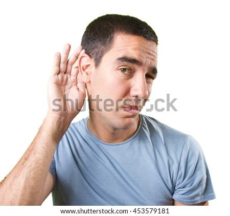 Close up of a young man trying to listen - stock photo