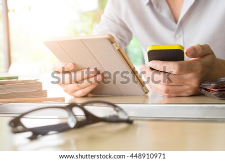 Close up of a young man using mobile smart phone and tablet focus on his hand with mining light - stock photo